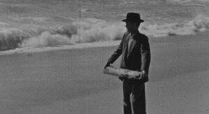 O Mar enrola na areia Img Pst